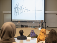 Female students watch Suzanne Piotrowski's keynote speech at the RIT Women's Leadership Conference