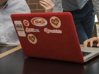 RIT students work on a laptop