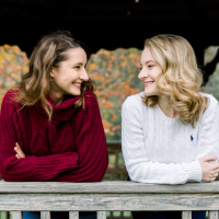 Claire and Ann-Katherine Candelori share a moment in a gazebo on RIT campus