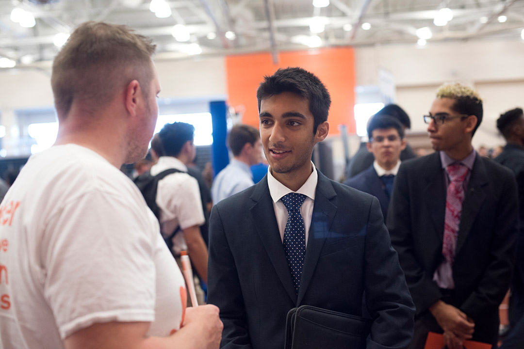 RIT students and prospective employers network at the Fall Career Fair